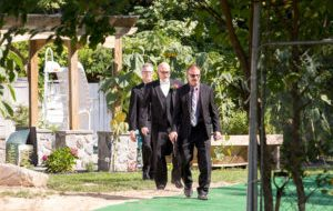 Groomsmen walking to ceremony site