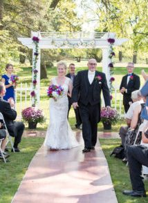 bride and groom walking down aisle leaving ceremony site