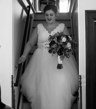 Bride descending stairs for her wedding