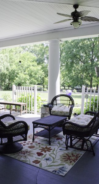 Wicker furniture on porch for guests enjoyment