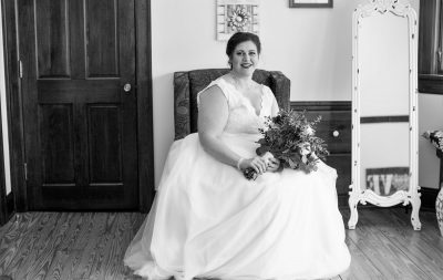 bride sitting in chair posing for her photo