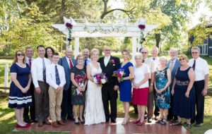 bridal party in front of wedding gazebo