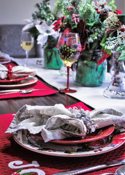 table set with Christmas placesettings and decor