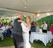 bride dancing with groom at the reception