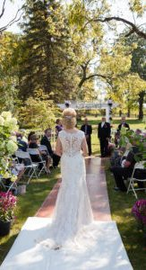 Bride walking down aisle to ceremony site