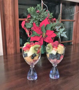 Christmas decor and fresh fruit in glasses