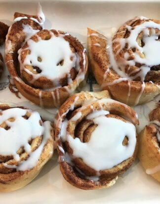 Tasty cinnamon rolls topped with sugared icing