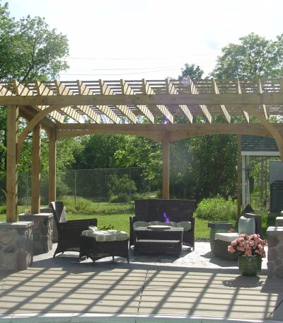 Pergola is inviting with several nice chairs for relaxing.