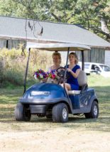 2 ladies riding on four-wheeler