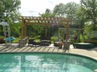 Inviting pool with slide near the pergola.